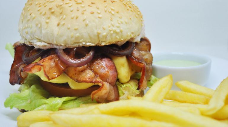 Luiz de Paula/ Divulgação - Wall Street: hambúrguer com sabor novaiorquino tem 160g de carne pura